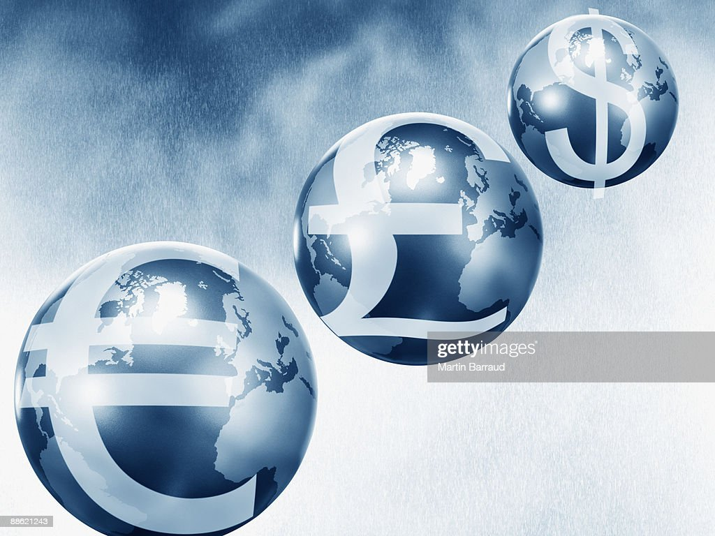 Globes with euro, pound and dollar symbols : Stock Photo