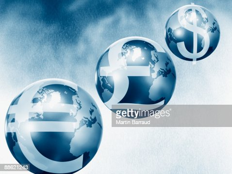 Globes with euro, pound and dollar symbols : Stock Photo