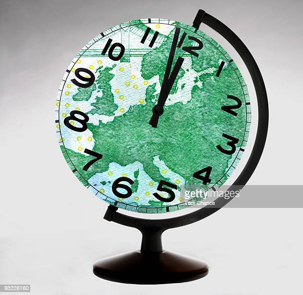 Globe-shaped clock, close-up (digital composite)
