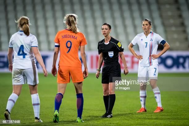 Glodis Perla Viggosdottir of Iceland Vivianne Miedema of the Netherlands referee Tina Tyteca Sara Bjork Gunnarsdottir of Icelandduring the friendly...