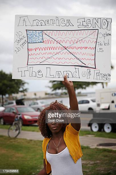 Gloria Alcius protests the George Zimmerman verdict at Mellon Park on July 14 2013 in Sanford Florida Yesterday Zimmerman a neighborhood watch...