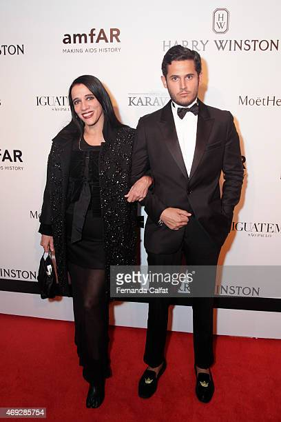 Gloria Coelho and Guest attends the 5th Annual amfAR Inspiration Gala at the home of Dinho Diniz on April 10 2015 in Sao Paulo Brazil