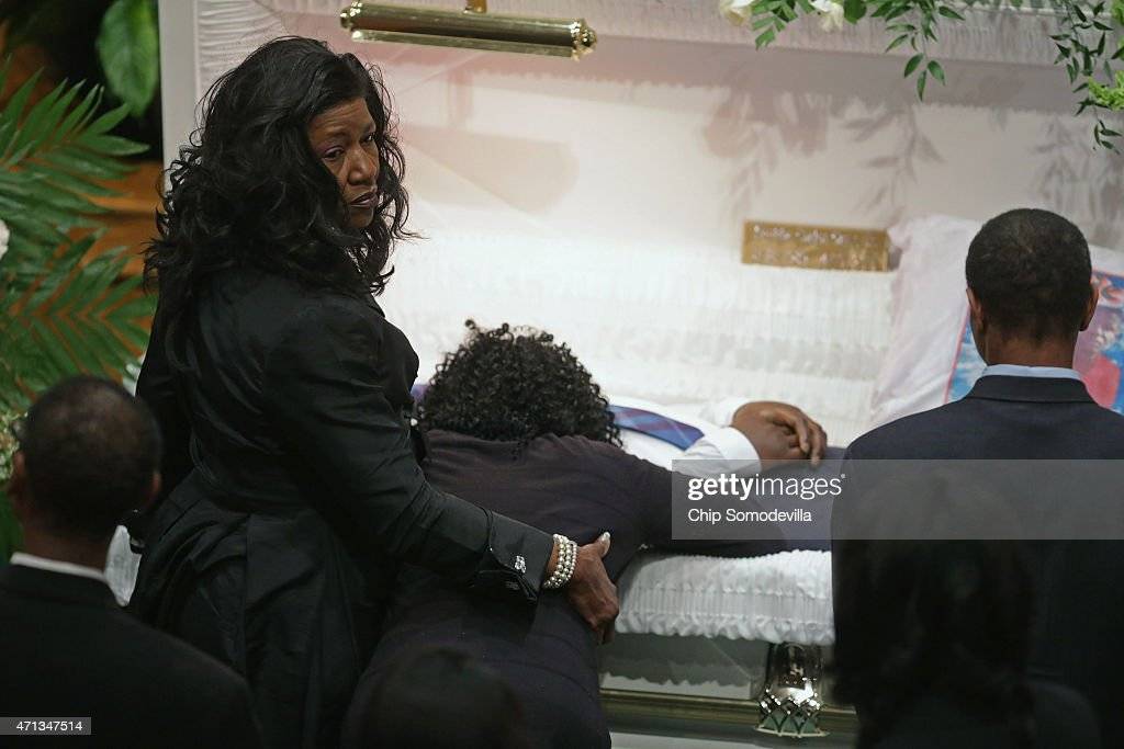 Gloria Darden (2nd R), Freddie Gray's mother, leans into his casket during his funeral at the New Shiloh Baptist Church April 27, 2015 in Baltimore, Maryland. Gray, 25, was arrested for possessing a switch blade knife April 12 outside the Gilmor Homes housing project on Baltimore's west side. According to his attorney, Gray died a week later in the hospital from a severe spinal cord injury he received while in police custody.