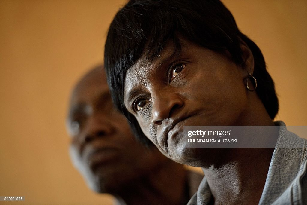 Gloria Darden, mother of Freddie Gray, listens during a press conference at the law offices of Murphy, Falcon. & Murphy after Baltimore Police Officer Caesar Goodson Jr. was found not guilty on all charges in Gray's murder trial June 23, 2016 in Baltimore, Maryland. Baltimore policeman Caesar Goodson, facing the most serious charges in the death of African-American Freddie Gray, was acquitted Thursday in a case that sparked riots and fueled a national debate over how US police treat young black men. / AFP / Brendan Smialowski