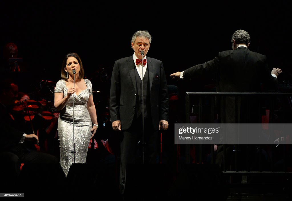 <a gi-track='captionPersonalityLinkClicked' href=/galleries/search?phrase=Gloria+Estefan&family=editorial&specificpeople=201703 ng-click='$event.stopPropagation()'>Gloria Estefan</a> and <a gi-track='captionPersonalityLinkClicked' href=/galleries/search?phrase=Andrea+Bocelli&family=editorial&specificpeople=211558 ng-click='$event.stopPropagation()'>Andrea Bocelli</a> perform at BB&T Center on February 14, 2014 in Sunrise, Florida.