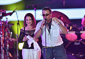 Gloria Estefan and Andy Garcia on stage during the Miami Beach 100 Centennial Concert on March 26 2015 in Miami Beach Florida