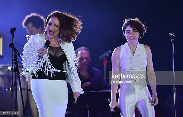 Gloria Estefan and daughter Emily Estefan on stage during the Miami Beach 100 Centennial Concert on March 26 2015 in Miami Beach Florida