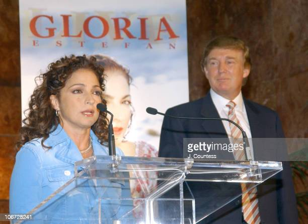 Gloria Estefan and Donald Trump during Gloria Estefan Announces her 'Live and ReWrapped' Final Concert Tour Summer 2004 at Trump Tower in New York...