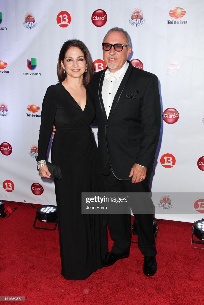 <a gi-track='captionPersonalityLinkClicked' href=/galleries/search?phrase=Gloria+Estefan&family=editorial&specificpeople=201703 ng-click='$event.stopPropagation()'>Gloria Estefan</a> and <a gi-track='captionPersonalityLinkClicked' href=/galleries/search?phrase=Emilio+Estefan&family=editorial&specificpeople=210517 ng-click='$event.stopPropagation()'>Emilio Estefan</a> arrive at Sabado Gigantes 50th Anniversary Gala Red Carpet at JW Marriott Marquis on October 28, 2012 in Miami, Florida.