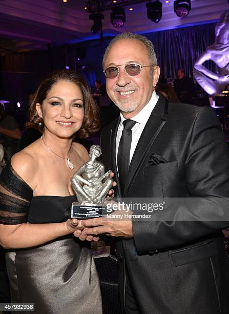 Gloria Estefan and Emilio Estefan attends Latin Songwriters Hall Of Fame La Musa Awards at Ritz Carlton South Beach on October 18 2014 in Miami Beach...
