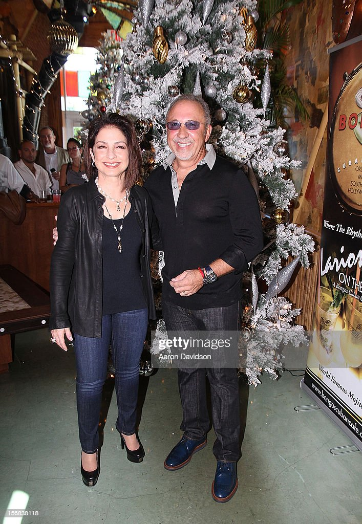 Gloria Estefan and Emilio Estefan participate in 5th Annual Thanksgiving Feed A Friend at Bongos on November 22, 2012 in Miami, Florida.