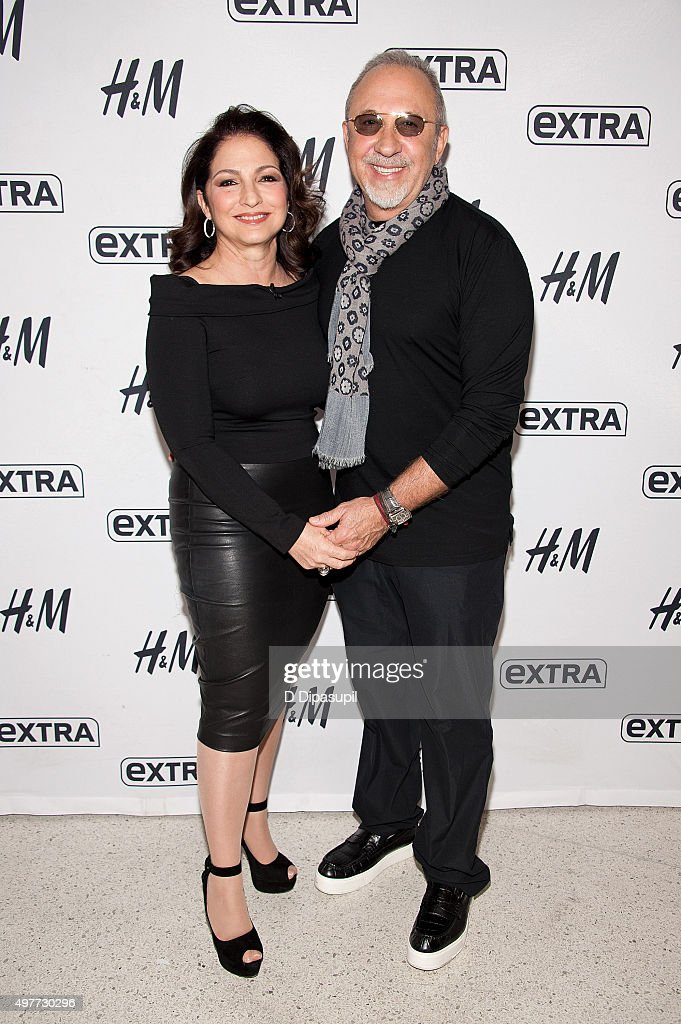 Gloria Estefan (L) and Emilio Estefan visit 'Extra' at their New York Studios at H&M in Times Square on November 18, 2015 in New York City.