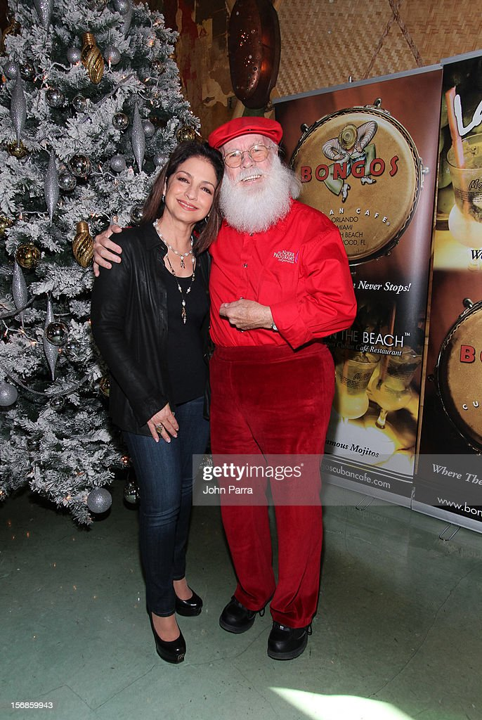 Gloria Estefan and Santa Claus participate in 5th Annual Thanksgiving Feed A Friend at Bongos on November 22, 2012 in Miami, Florida.