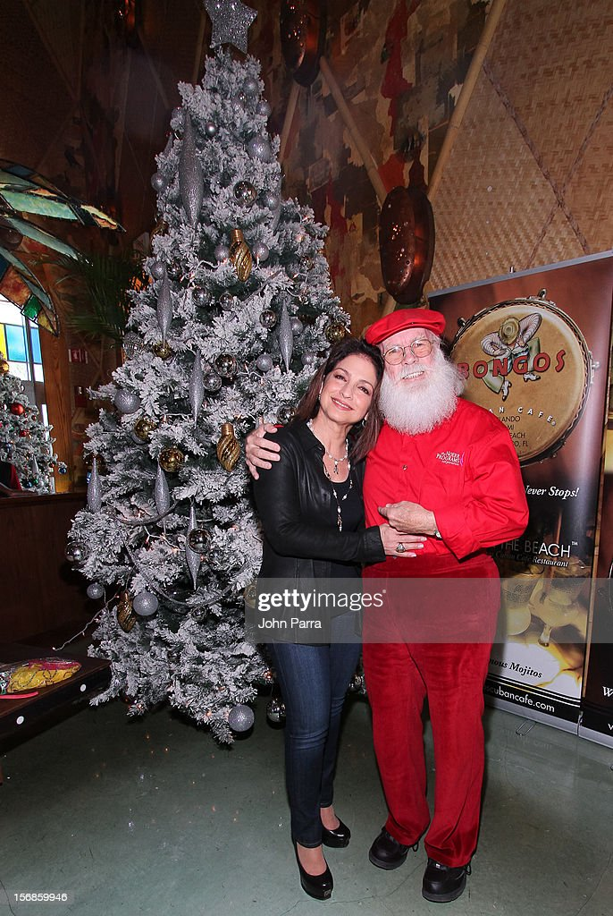 <a gi-track='captionPersonalityLinkClicked' href=/galleries/search?phrase=Gloria+Estefan&family=editorial&specificpeople=201703 ng-click='$event.stopPropagation()'>Gloria Estefan</a> and Santa Claus participate in 5th Annual Thanksgiving Feed A Friend at Bongos on November 22, 2012 in Miami, Florida.