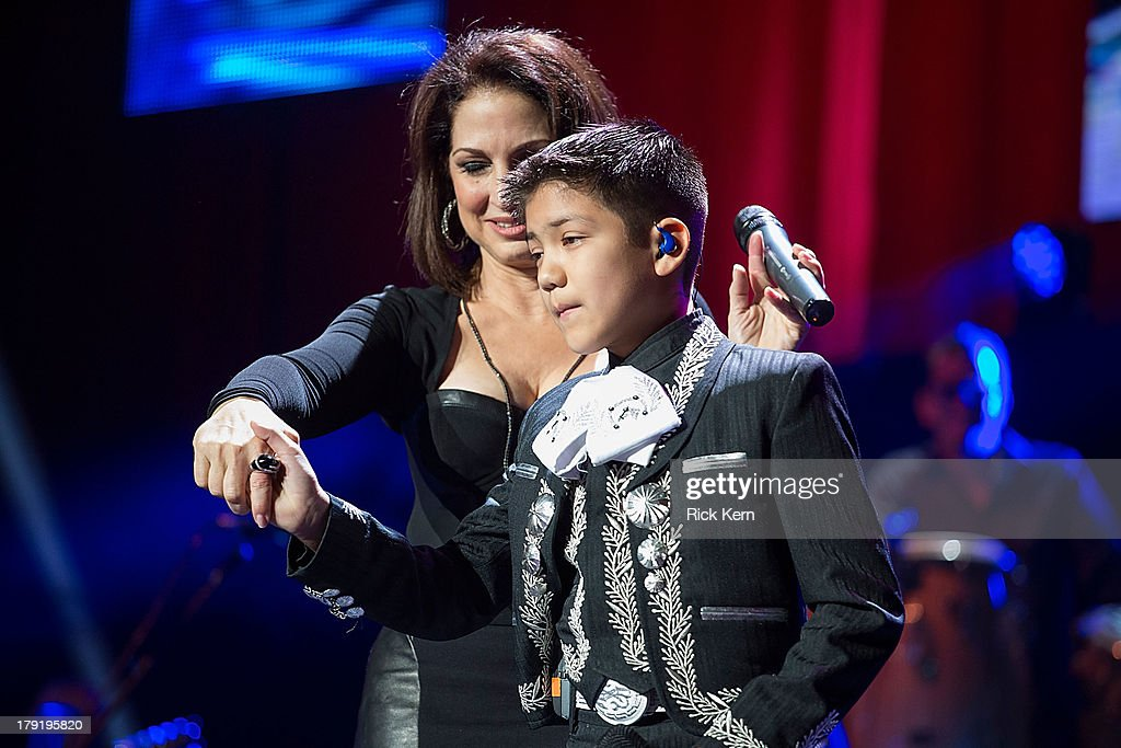 <a gi-track='captionPersonalityLinkClicked' href=/galleries/search?phrase=Gloria+Estefan&family=editorial&specificpeople=201703 ng-click='$event.stopPropagation()'>Gloria Estefan</a> and <a gi-track='captionPersonalityLinkClicked' href=/galleries/search?phrase=Sebastien+de+la+Cruz&family=editorial&specificpeople=10988277 ng-click='$event.stopPropagation()'>Sebastien de la Cruz</a> perform at the Festival People en Español Presented by Target at The Alamodome on August 31, 2013 in San Antonio, Texas.
