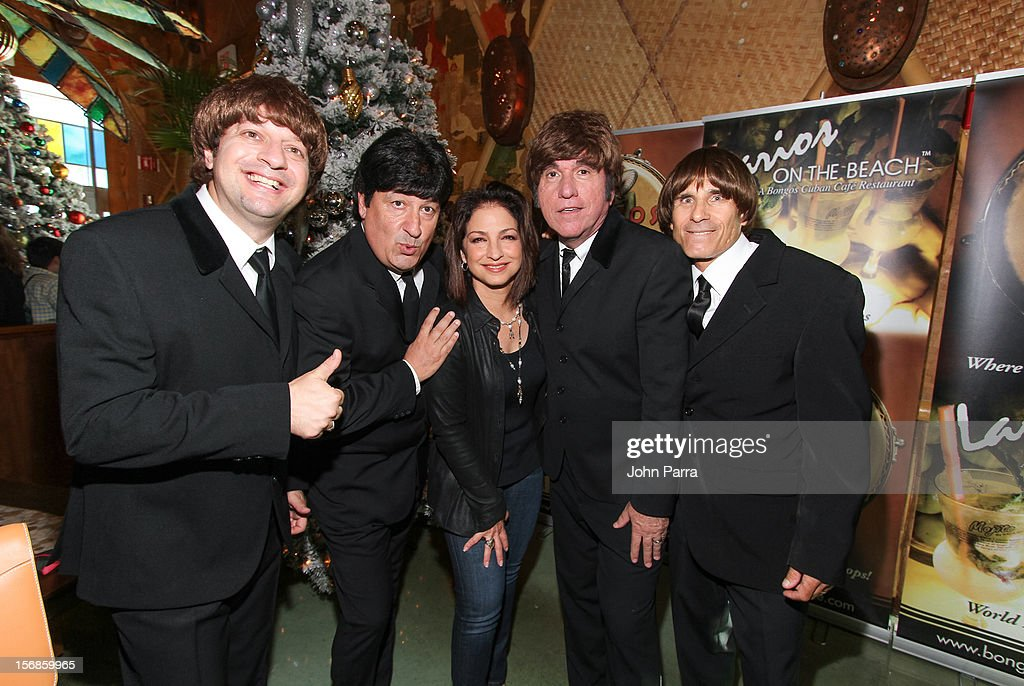 <a gi-track='captionPersonalityLinkClicked' href=/galleries/search?phrase=Gloria+Estefan&family=editorial&specificpeople=201703 ng-click='$event.stopPropagation()'>Gloria Estefan</a> (C) with The Beatles inpersontors participate in 5th Annual Thanksgiving Feed A Friend at Bongos on November 22, 2012 in Miami, Florida.