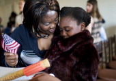 Gloria Gao originally from Sudan gets a hug from her mother Mary Zrara during in a citizenship ceremony at President Lincolns Cottage in Northwest...