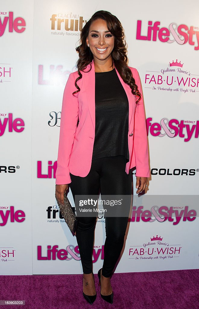 Gloria Govan arrives at Life & Style's Hollywood In Bright Pink Event Hosted By Giuliana Rancic at Bagatelle on October 9, 2013 in Los Angeles, California.