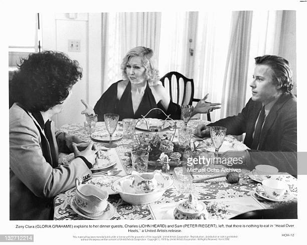 Gloria Grahame explains to her guests Peter Riegert and John Heard that there is nothing to eat in a scene from the film 'Head Over Heels' 1979