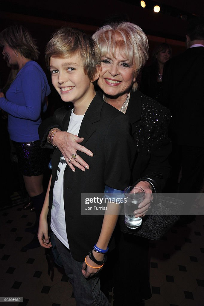Gloria Hunniford and grandson Gabriel attend the PINKTOBER Women Of Rock Charity Concert at the Royal Albert Hall on November 1 2009 in London England