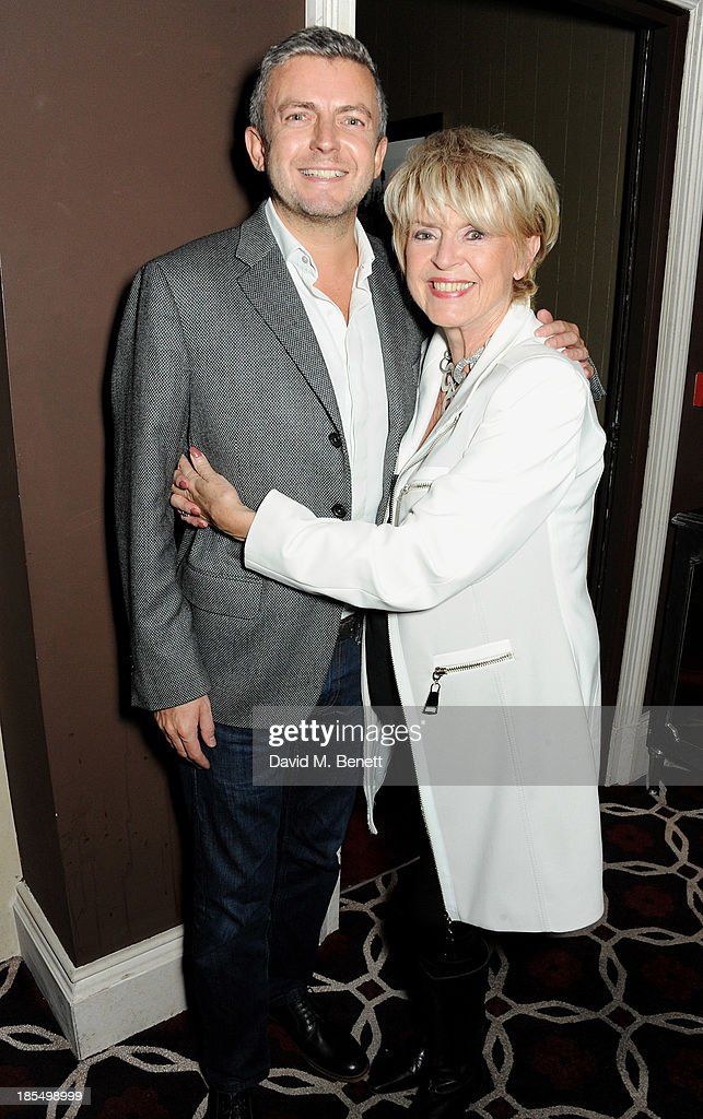 Gloria Hunniford (R) and Michael Keating attend the launch of Joan Collins new book 'Passion For Life' at No.41 Mayfair Club at The Westbury Hotel on October 21, 2013 in London, England.