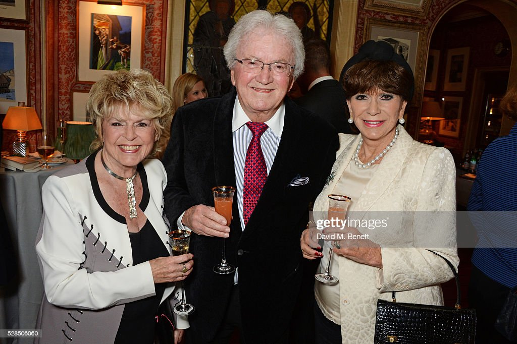 Gloria Hunniford, Leslie Bricusse and Yvonne Romain attend the launch of Dame Joan Collins' new book 'The St. Tropez Lonely Hearts Club' at Harry's Bar on May 5, 2016 in London, England.