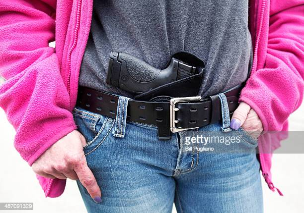 Gloria LincolnThompson of Garden City Michigan carries her Smith Wesson Shield 9mm pistol in her belt while participating in a rally and march...