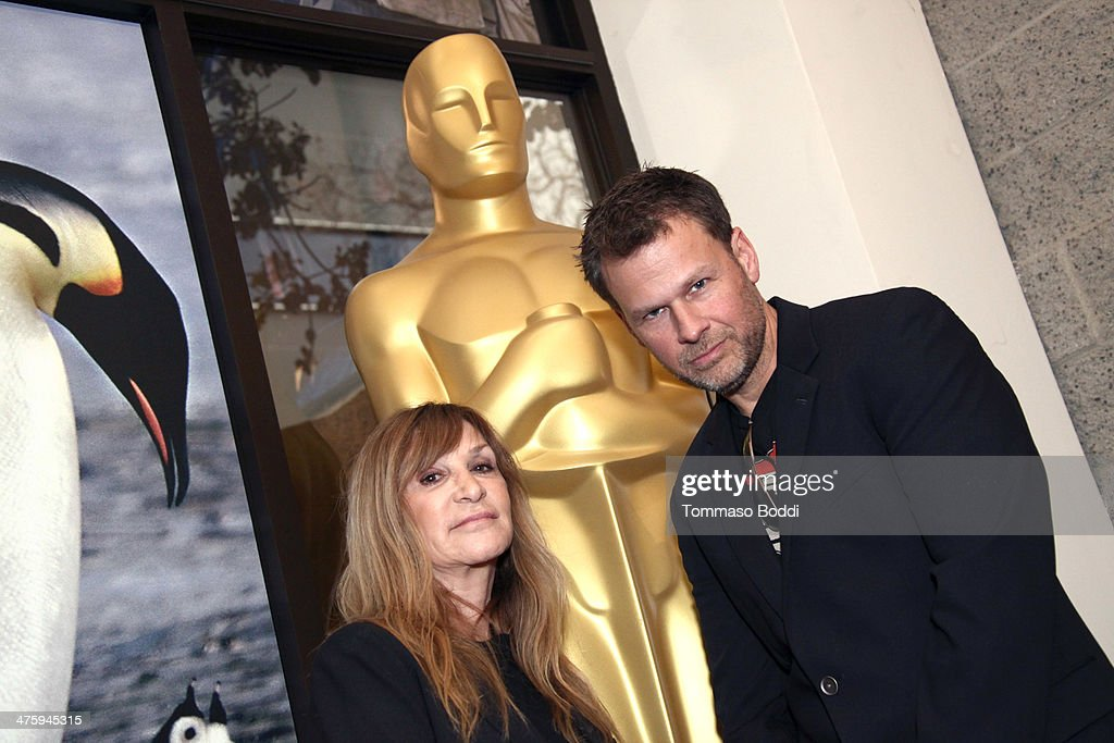 Gloria Pasqua Casny (L) and Joel Harlow attend the 86th Annual Academy Awards - Makeup And Hairstyling at the AMPAS Samuel Goldwyn Theater on March 1, 2014 in Beverly Hills, California.