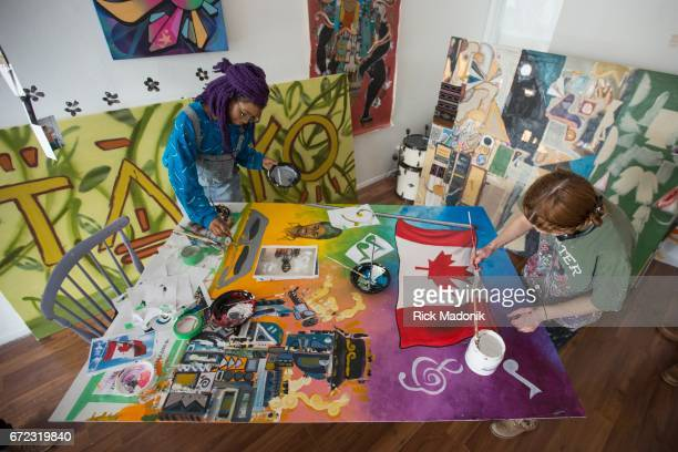 Gloria Romy Asse 19 and Frances Potts work on a piece together A project which brings youth and art together in celebration of Canada's 150th...