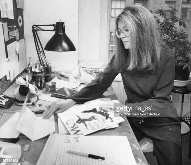 Gloria Steinem feminist leader and founder of 'Ms' magazine at her desk