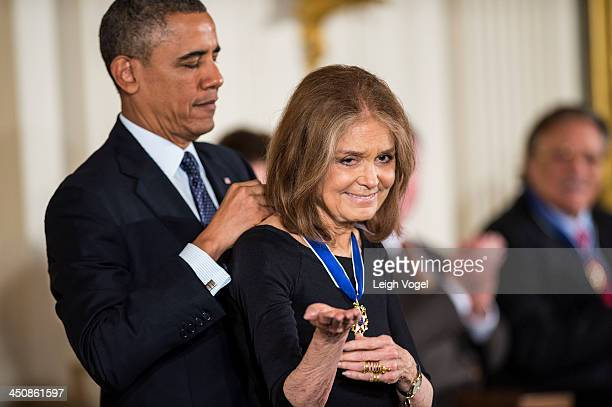 Gloria Steinem receives the 2013 Presidential Medal of Freedom from President Barack Obama at the White House on November 20 2013 in Washington DC