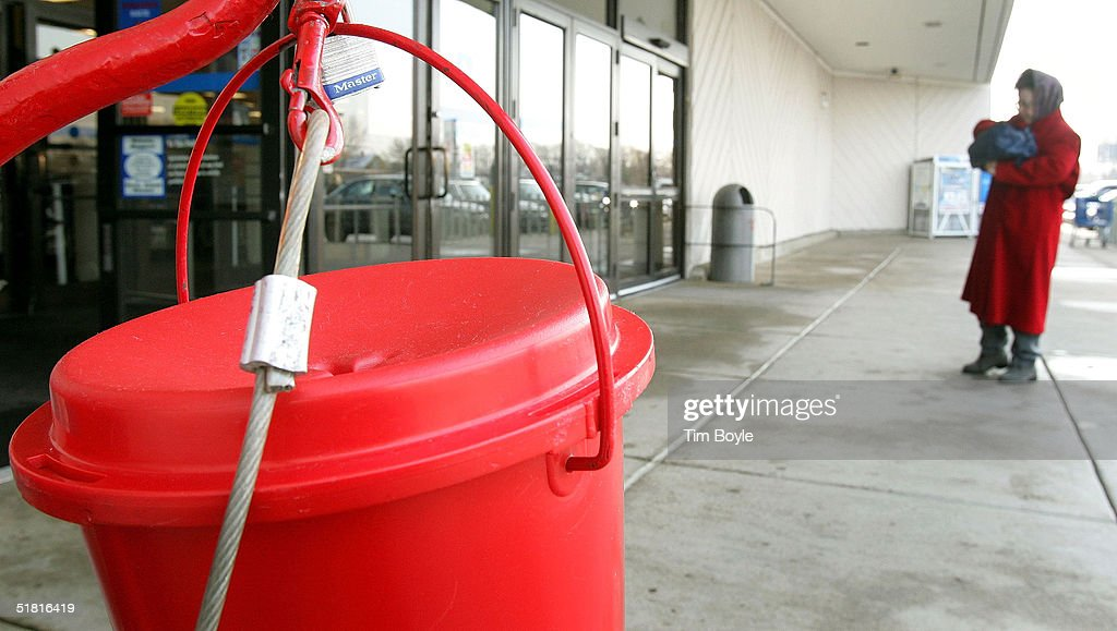 Gloria Thompson collects her change prior to making a donation into the kettle of Salvation Army bell ringer Delores Wright in front of a Kmart store...