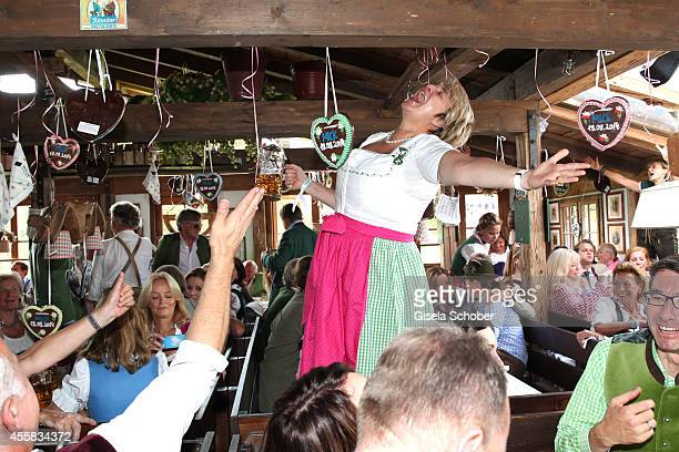 Gloria von Thurn und Taxis sings during the Oktoberfest Opening in Kaeferzelt at Theresienwiese on September 20 2014 in Munich Germany
