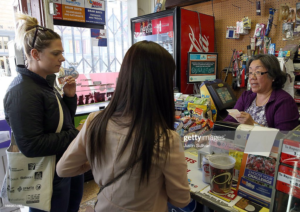 Gloria Yee (R) sells Powerball tickets at her corner store on May 17, 2013 in San Francisco, California. People are lining up to purchase $2 Powerball tickets as the multi-state jackpot hits $600 million.