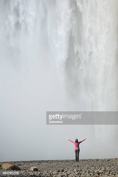 Glorious Waterfall - Woman With Arms Raised By Giant Cascade