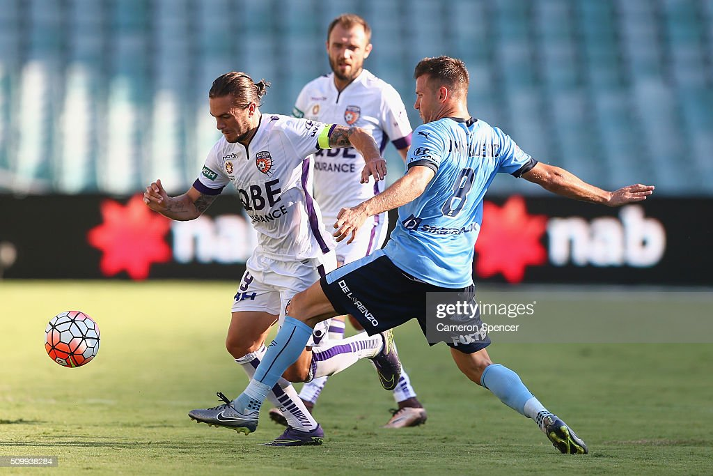 Glory Captain Joshua Risdon is tackled during the round 19 A-League match between Sydney FC and the Perth Glory at Allianz Stadium on February 13, 2016 in Sydney, Australia.