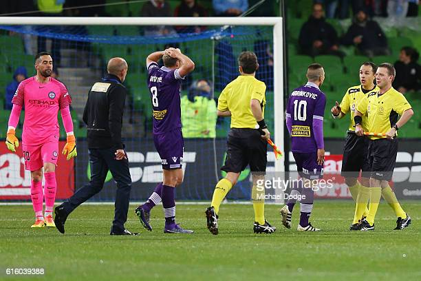 Glory head coach Kenny Lowe and Nebojsa Marinkovic of the Glory react at half time after conceding a penalty goal during the round three ALeague...