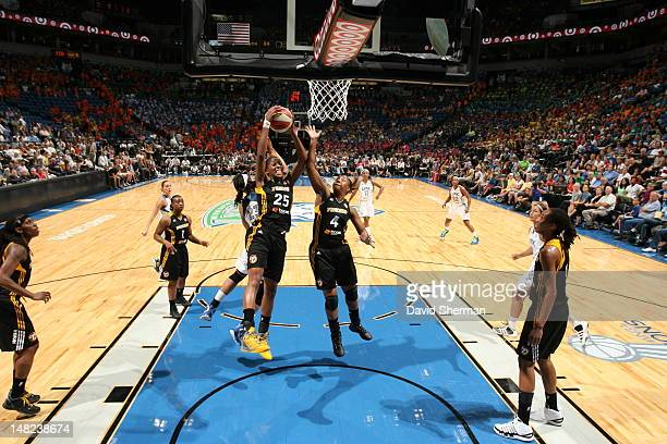 Glory Johnson and Amber Holt of the Tulsa Shock go for the rebound in the WNBA game against the Minnesota Lynx on July 12 2012 at Target Center in...