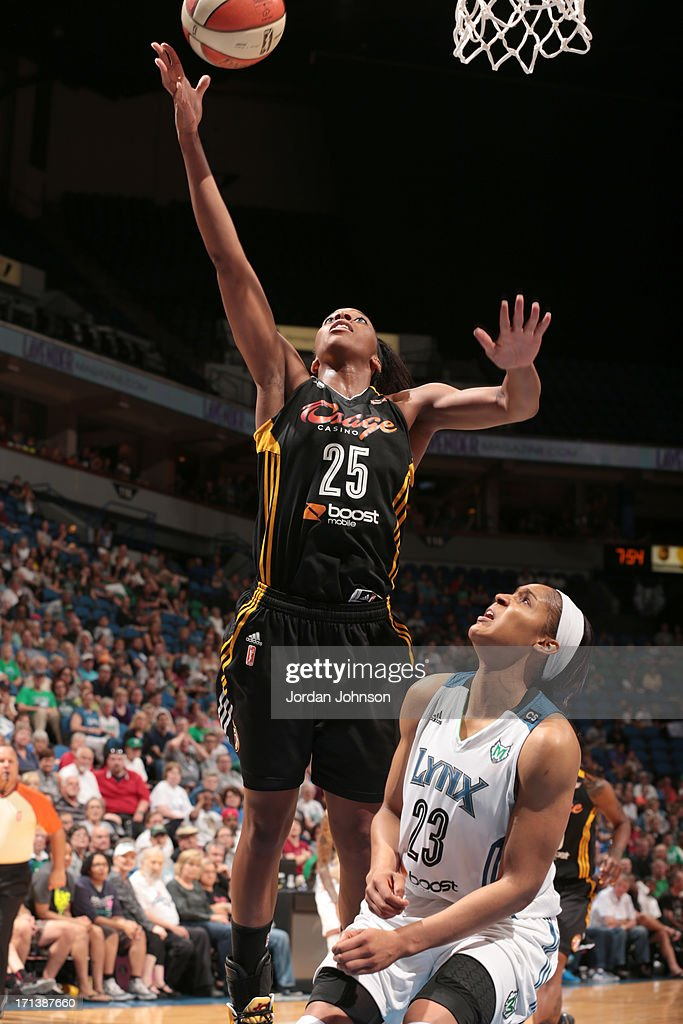 Glory Johnson #25 of the the Tulsa Shock shoots against <a gi-track='captionPersonalityLinkClicked' href=/galleries/search?phrase=Maya+Moore&family=editorial&specificpeople=4215914 ng-click='$event.stopPropagation()'>Maya Moore</a> #23 of the Minnesota Lynx during the WNBA game on June 23, 2013 at Target Center in Minneapolis, Minnesota.