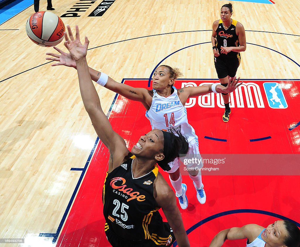 Glory Johnson #25 of the Tulsa Shock battles for a rebound against Erika de Souza #14 of the Atlanta Dream at Philips Arena on May 25, 2013 in Atlanta, Georgia.
