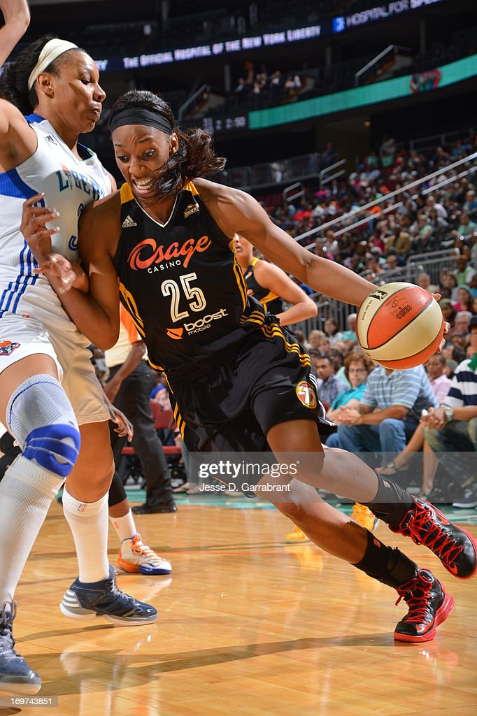 Glory Johnson #25 of the Tulsa Shock drives to the basket against the New York Liberty during the game on May 31, 2013 at Prudential Center in Newark, New Jersey.