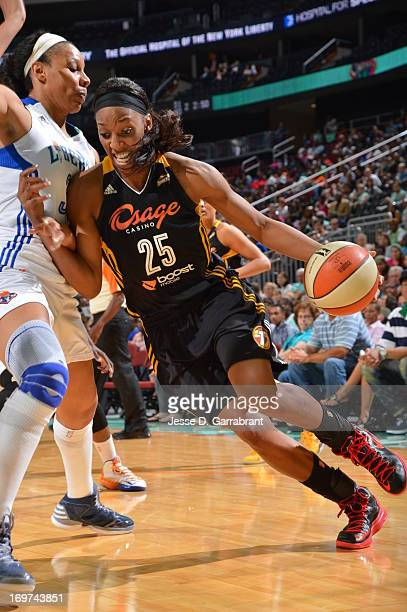Glory Johnson of the Tulsa Shock drives to the basket against the New York Liberty during the game on May 31 2013 at Prudential Center in Newark New...