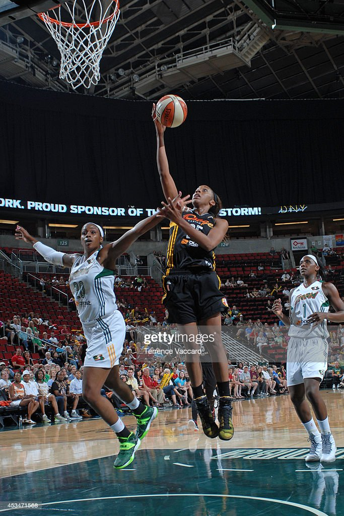 Glory Johnson #25 of the Tulsa Shock goes to the basket against Camille Little #20 of the Seattle Storm during the game on August 10,2014 at Key Arena in Seattle, Washington.