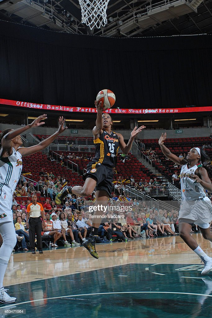 Glory Johnson #25 of the Tulsa Shock goes to the basket against Crystal Langhorne #1 of the Seattle Storm during the game on August 10,2014 at Key Arena in Seattle, Washington.