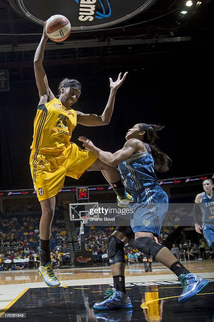 Glory Johnson #25 of the Tulsa Shock grabs a rebound against the Minnesota Lynx during the WNBA game on June 14, 2013 at the BOK Center in Tulsa, Oklahoma.