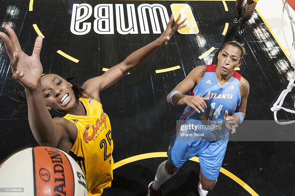 Glory Johnson #25 of the Tulsa Shock reaches for a rebound against Erika de Souza #14 of the Atlanta Dream during the WNBA game on July 21, 2013 at the BOK Center in Tulsa, Oklahoma.
