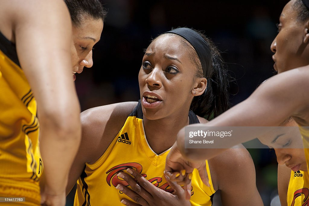 Glory Johnson #25 of the Tulsa Shock talks with teammates during the WNBA game against the Indiana Fever on July 25, 2013 at the BOK Center in Tulsa, Oklahoma.
