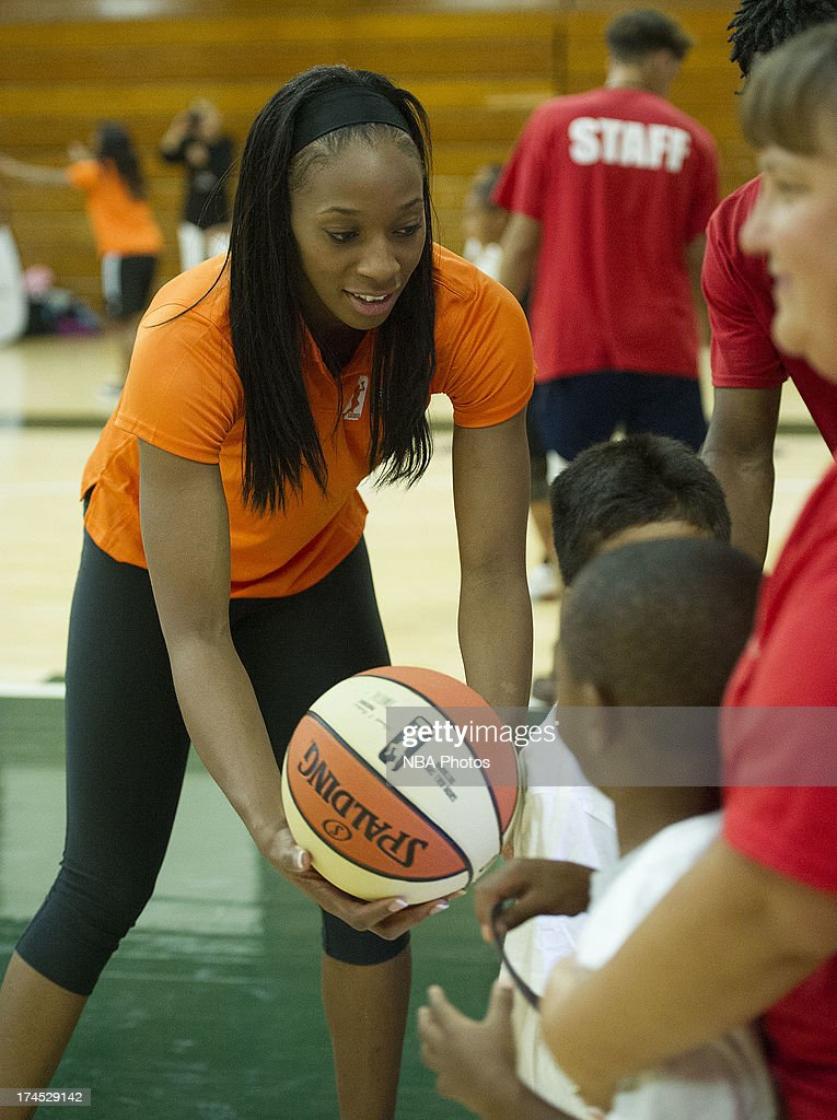 Glory Johnson of the Tulsa Shock works with children during the WNBA Cares Jamba Juice FIT Clinic on July 26, 2013 at Benjamin Dover Jackson Middle School in New London, Connecticut.