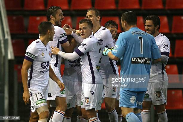 Glory players celebrate a goal during the round 24 ALeague match between the Newcastle Jets and Perth Glory at Hunter Stadium on April 6 2015 in...
