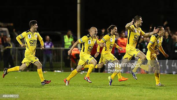 Glory players celebrate after winning the game on penalty shoot outs during the FFA Cup Quarter Final match between the Perth Glory and Western...